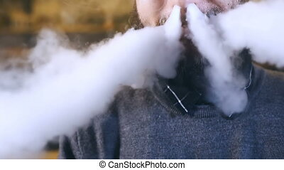 Man smoking electronic cigarette vapor.