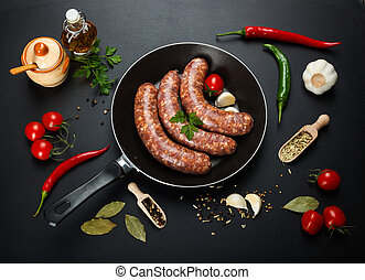 Top view of homemade pork sausages in frying pan