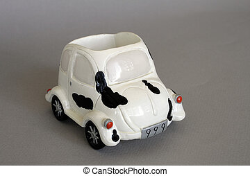 Toy car - Small toy cermic car in isolated over gray
