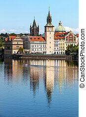 View of the church clock in Prague with the Vltava river in...