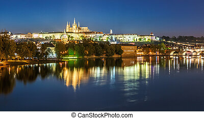 Evening cityscape of Prague with Saint Vitus Cathedral,...