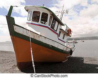 Fisher boat moored - Boat moored, staying on the sand in...
