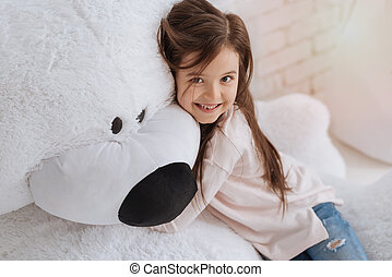 Pretty delighted girl hugging her stuffed animal - My best...