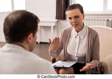 Positive professional therapist giving advice - Dealing with...