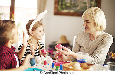 Family together decorating Easter eggs