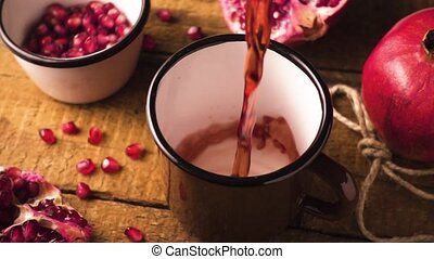 Slow mo pomegranate juice in a mug - Slow mo pomegranate...