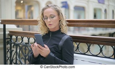 Woman in black with phone