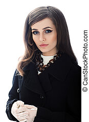 Fashion portrait of young confident woman in retro style...