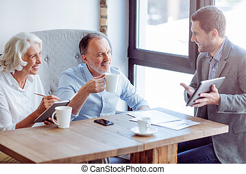 Positive aged couple meeting with sales manager - Important...