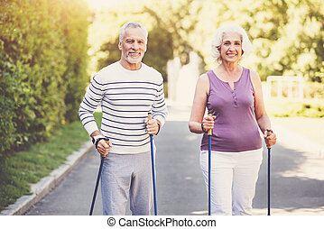 Cheerful elderly couple keeping fit - Active lifestyle....