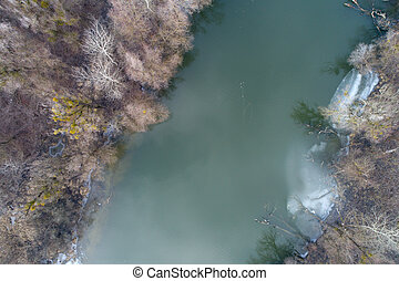 Aerial image of frozen river - Top view of frozen river with...
