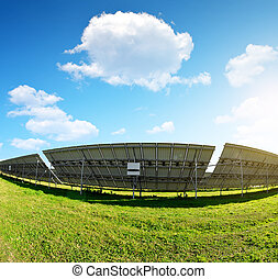 Photovoltaic panels on meadow. Power plant using renewable...
