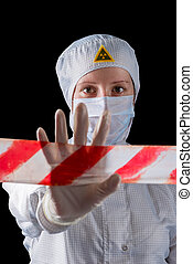 Worker in protective clothing showing hand gesture STOP...