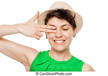 cheerful girl posing with a hat in the studio