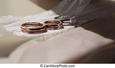 Three wedding rings on lace