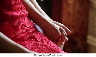 Young woman and her mom holding hands closeup