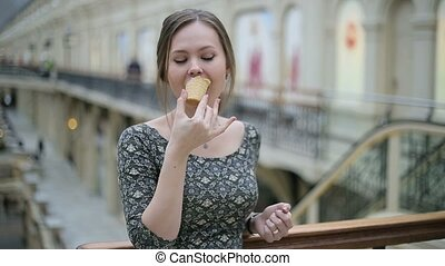 Young woman eat ice cream.