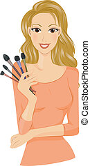 Make Up Brushes - A Smiling Lady Holding Different Kinds of...