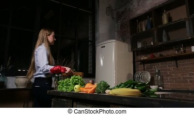 Young woman cooking healthy smoothie in kitchen - Attractive...