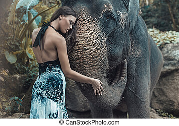 Pretty lady hugging a lovely indian elephant - Pretty woman...