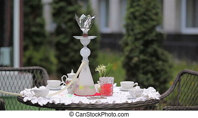 Close-up glass hookah on table, outdoor
