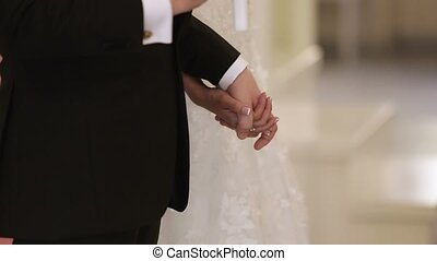 Bride and groom holding hands on ceremony - Bride and groom...