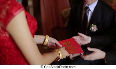Bride gives red envelope to brothers at wedding day
