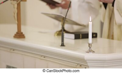 Priest at church - Candle, priest at church on background