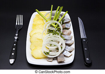 Dutch national appetizer, herring with onions. Tasty pieces...