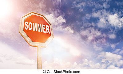 Sommer (German summer) on red traffic road stop sign -...