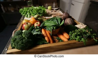Set of fresh vegetables and fruits on wooden tray - Set of...