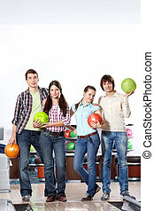 Active people - Young attractive people with spheres in...