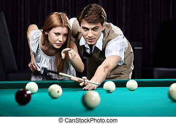 The billiards - The young girl and the guy discuss a blow...