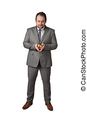 Businessman isolated on white holding golden egg in a hand