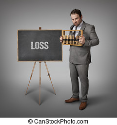 Loss text on blackboard with businessman