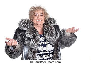 Senior woman in fur shrug the hand - Senior woman in fur...