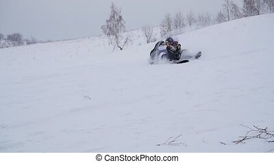 happy family rides and falls with ledyanki on snowy roads. Slow motion. Snow winter landscape. Outdoor sports