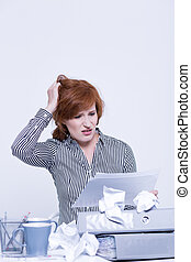 Clutter on desk during work of female employee