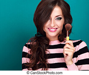 Beautiful makeup happy woman holding and advertising make-up...