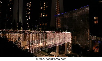 Street in Singapore decorated with luminous garlands....