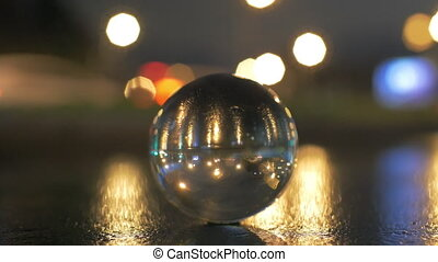 View of glass sphere imaging inverted cityscape with road
