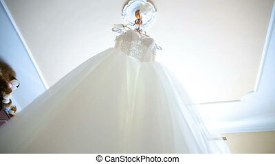The perfect wedding dress in the room of the bride. - The...