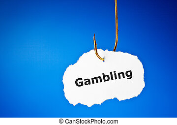 Hooked On Gambling Concept - The word Gambling on a piece of...