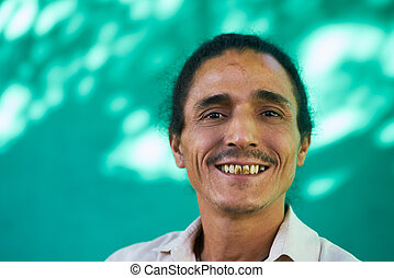 Happy People Portrait Of Latino Man With Goatee Laughing