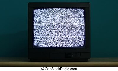 TV no signal - Static noise on an old TV in a dim room