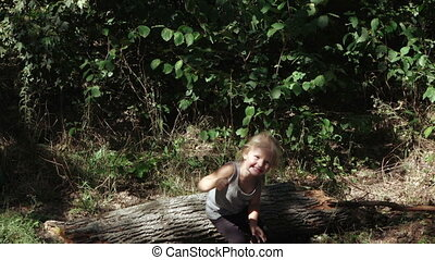 Girl jumping from logs