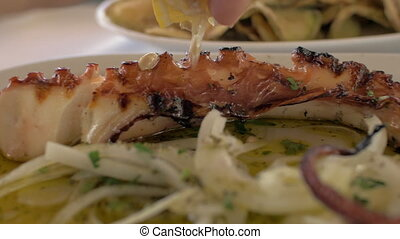 Having dish with fried octopus - Close up shot of having...