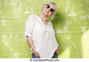 Fashionable senior woman posing. - Fashionable beautiful...