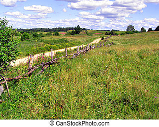 old fence near rural road