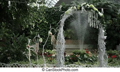 Wedding ceremony decoration in greenhouse